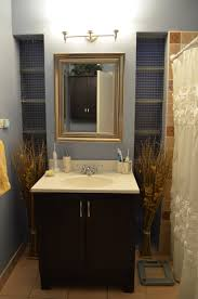 bright bathroom interior with clean white wash basin on black wooden bathroom vanity added by
