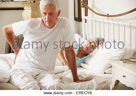Back Pain When Getting Out Of Chair Senior Man Suffering From Back Pain Whilst Gardening Stock Photo