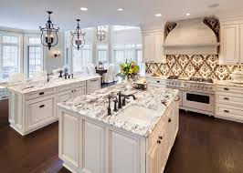 Kitchens With 2 Islands by A Graphic Gold And White Backsplash Pops In This Elegant