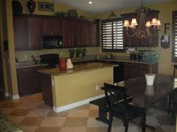 good kitchen idea for family gathering dark cabinets wall color