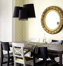 gold round mirror with elegant black pendant lamps and classic