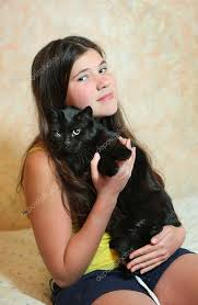 black preteen hair preteen beautiful girl with dark long hair hold black cat stock