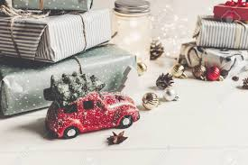 modern ornaments and car with tree presents cones