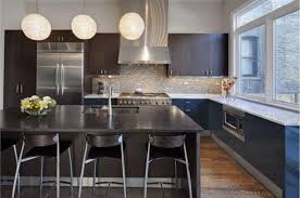 simplifying remodeling two tone cabinet finishes double kitchen style glossy acrylic base cabinets add a sleek reflective note to this streamlined kitchen their juxtaposition with the matte island and upper cabinets