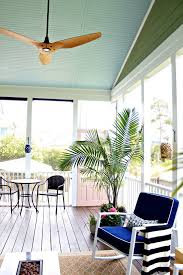 a fresh colorful screened porch ideal for summer entertaining