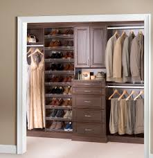 luxurious brown walnut wood closet organizer with cabinet door of