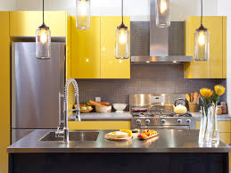 white cabinets island sink and refrigerator pastel yellow