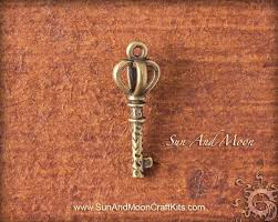 small skeleton key charm antiqued brass finish