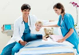 Doctor And Nurse Little Boy Looking At An X Ray With His Doctor And Nurse Stock