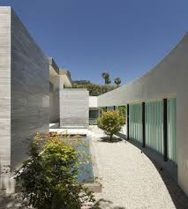 home with glass screen and water features in entry courtyard