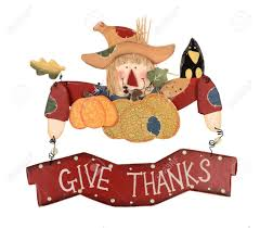 wooden thanksgiving scarecrow decoration with a sign give thanks