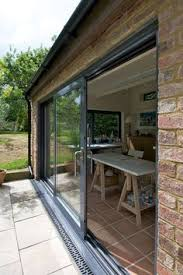 external sliding glass doors simple landscaped city garden with large sliding doors at the end