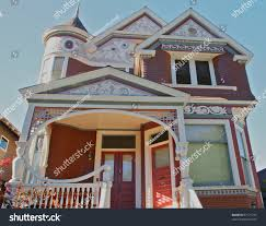 House With Tower Victorian Burgundy Gingerbread House Brightly Lit Stock Photo