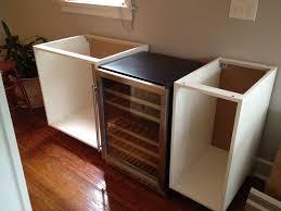 installed refrigerator surround mdf board around fridge wood