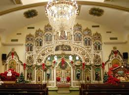 people decorating church for christmas interior design