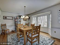 country dining room with bay window u0026 hardwood floors in