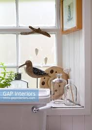 gap interiors ornaments on windowsill toilet image no