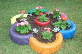 flower bed made from old tires and small tire in the center my flower bed made from old tires and small tire in the center