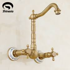 wall mounted kitchen sink faucets aliexpress buy swivel spout two handle wall mounted kitchen