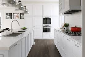 white kitchen cabinets with oak floors engineered oak floors transitional kitchen destination