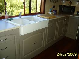 cabinets custom made to suit the farmers sink kitchens by