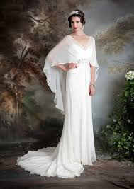 wedding dress up for picture of a spaghetti wedding dress with a sheer cape on