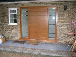 single wooden front doors with frosted glass panels for house