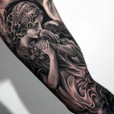 religious inner arm tattoos work