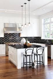 white kitchen cabinets with black subway tile backsplash black subway tiles contemporary kitchen glynn