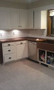 flooring white kitchen cabinets with tile backsplash and cozy