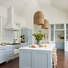 what color to paint kitchen island with white cabinets 7 paint colors we re loving for kitchen cabinets in 2021