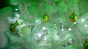 bright illuminations on tree christmas white decorated fir tree