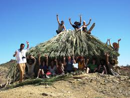 maharishiu sustainable living students build adobe house from