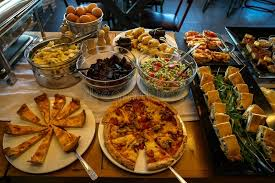 cuisine etc breakfast buffet table with varieties of pizza pies