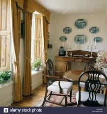 dining room curtain designs blue and white plates above antique sideboard in country dining