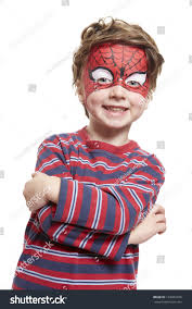 young boy face painting spiderman smiling stock photo 124961036
