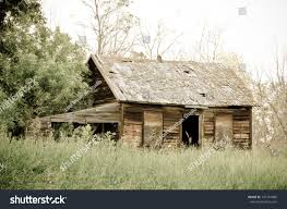 abandoned old farm house overgrown yard stock photo 107154986