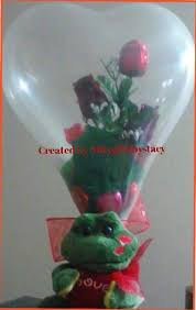balloons with gifts inside created by niftygiftsbystacy stuffed inside heart