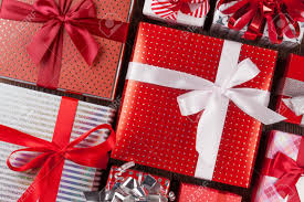 christmas gift boxes on wooden table top view closeup stock photo