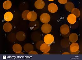 bright orange fairy lights with a dark back background using a