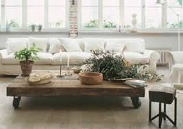 very low coffee table wooden rustic low coffee table decorated with plants white living