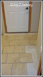 newly tiled mudroom floor and attached bathroom hometalk