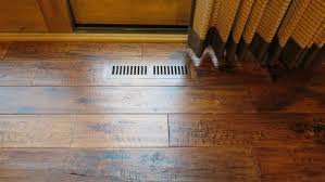 two different wood floors meet kitchen flooring at doorways