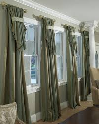 decorating den interiors shelley rodner c i d custom window all the trimmings in traditional living room mixes old with new from hgtv dont like the color but interesting window treatment for multiple windows