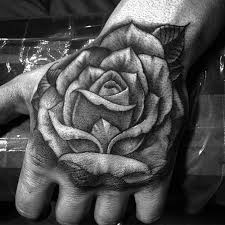 freehand rose hand tattoo by sir twice tattoonow