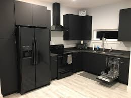 black kitchen cabinets in a small kitchen modern matte black kitchen modern kitchen miami by