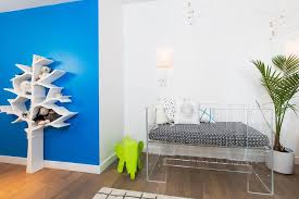 white and blue modern nursery with nurseryworks tree bookcase