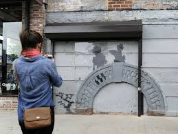 section of wall containing banksy s banksy new york