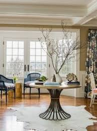 an antique pedestal table in the foyer sets the home u0027s casual tone