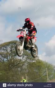 freestyle motocross ramps motocross biker airborne during jump from ramp stock photo